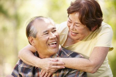 42108866 - portrait romantic senior asian couple outdoors